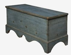 """LIGHT BLUE BLANKET CHEST WITH ELABORATE SCALLOPED SKIRT New York or New England, c. 1800. Six-board blanket chest with dynamic shaped apron in original powder blue. 48"""" l. x 24"""" h. x 19 1/2"""" d. Strap hinges replaced $ 3500."""
