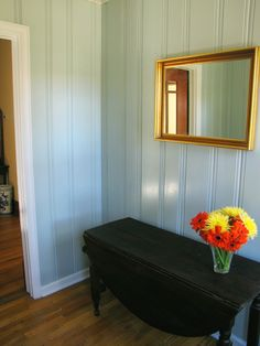 I can't decide if I want to paint my knotty pine basement or leave it how it is. I really like the results this homeowner had with her paneled wall.
