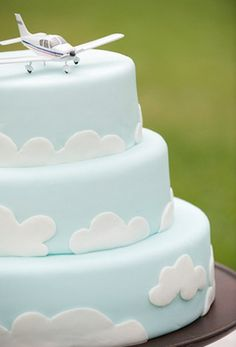 Cloud tiered cake with an airplane topper