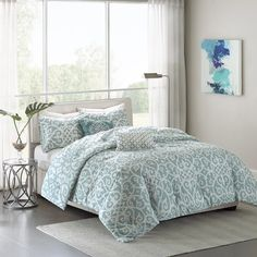 The Madison Park Elena Reversible Duvet Cover Set creates an organic look for your space. Featuring an updated fretwork design, this duvet is fully reversible with a textured base and off white motif flipping to a textured grey reverse and aqua motif. King Comforter Sets, Duvet Sets, Duvet Cover Sets, Bed Bath & Beyond, Aqua Blue, Color Blue, Blue Green, Console, Aqua Bedding