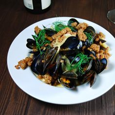 Fresh mussels braised in wine and topped with spicy chorizo and garlicky fennel.