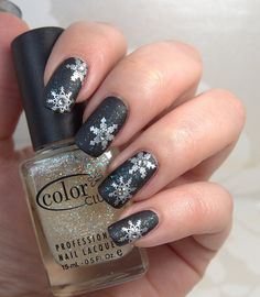 Matte black winter nails with non-matte snowflakes. Wow!