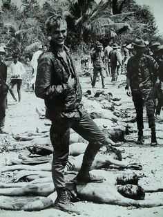 U.S. soldier posing with Viet Cong bodies during the Tet offensive. January 1968
