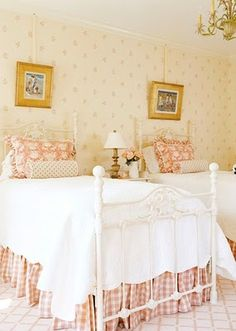 Cast iron bed with gingham bed skirt.