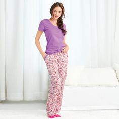 "Dream pretty dreams in these soft t-shirt pajamas. The top is solid purple with picot trim at the neckline. The floral-print pants have a drawstring waist with inner elastic and picot trim on the 2 front pockets. · 60% Cotton, 40% Polyester · Top - length from highest point of shoulder:  25 1/2"" (medium); 28 1/2"" (2X) · Pants – inseam:  S - XL 30 1/2"";1X-3X 29"" · Wash before wearing. Machine wash cold with like colors; do not use ..."
