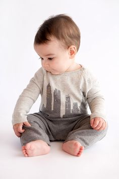 Lucky Jade Baby Products' fall-winter 2014 collection of cotton-cashmere garments are subtly colored, and sport whimsical motifs. Here, the one-piece with the skyline and Statue of Liberty makes us New Yorkers proud. www.luckyjadeproducts.com (designer preview)