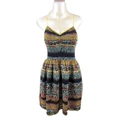"Band Of Gypsies Urban Outfitters Sz S Dress NWOT Band Of Gypsies Urban Outfitters Sz S Multi-Color V Neck Boho Stretch Adjustable Strap Dress with Pockets!Bust 32-36 stretchy, Length 36"" adjustable Polyester Color: Black / Yellow Tribal Lightweight  Print/Motif: Tribal / Aztec  Condition: New Without Tags Urban Outfitters Dresses"