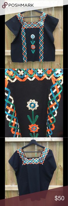 Mexican machine sewed ribbon top Machine sewed ribbon top. Floral design on front. Ribbon colors are white, orange, green and blue. From Oaxaca, Mexico. Tops