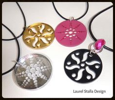 laser cut acrylic jewelry.Original designs inspired by crop circles.   Golden and silver mirror has depth. Pink and Black are opaque.