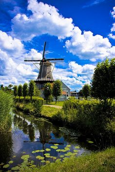 The Salamander Windmill on the Vliet canal in Leidschendam, South Holland, Netherlands.  Go to www.YourTravelVideos.com or just click on photo for home videos and much more on sites like this.