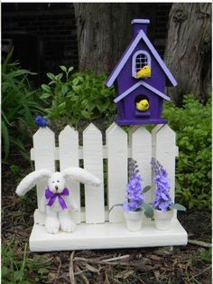 Birdhouse on fence with bunny.