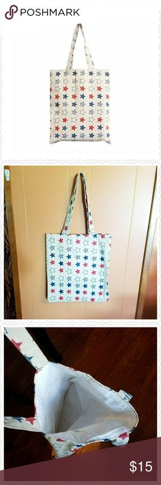 """Red, white and blue star canvas tote Cute summer tote bag. Red and blue star pattern on a beige canvas tote. Open top. One inside pocket. Fully lined.  Double straps. 100% cotton canvas. Approximate size is 15"""" by 13.5"""". 9.5"""" shoulder drop. New in package. Boutique  Bags Totes"""