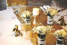 Gold sequined table runners at The Vineyard at Stockcross by Simply Bows and Chair Covers
