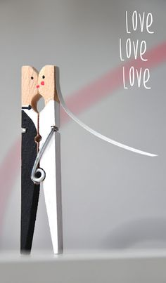 Bride and groom clothes pins... so cute! These could be used so many fun ways at a wedding!