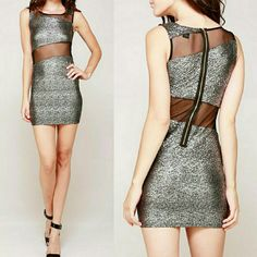 SILVER SHIMMER   Cut-out Dress Gorgeous gunmetal silver, glitter mini dress w/ black semi-sheer, mesh cutout panels & back zipper. Fully lined (except for mesh cutouts).  Sizes Available: M & L Material: 95% Polyester / 5% Spandex (self) & 92% Nylon / 8% Spandex (contrast) Clothing Care: Hand wash or Delicate Cycle (machine) Timing Dresses Mini