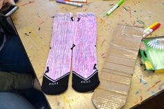 Sample of the fun craft activity we did with Brighton High Students. We took over their art class for a day and had them draw on Blank FEAT socks with fabric markers. This reminded us of some of the socks we have sold in the past!   #spreadingsmiles #weartheweekend www.featsocks.com