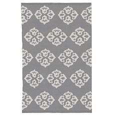 I am loving gray right now. I think that soft gray with lemon accents and graphic patterns would be a good combo.