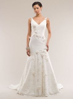 http://kirstiekelly.com/wedding/collectiononeDetail/c1-K1010.html