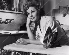 Susan Hayward finished ironing in photo from Back Street 835-25