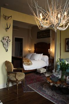 The leopard print cushion on the gold chair *MAKES* this room!  Love the overlapping rugs too. <3 I'd sleep here!