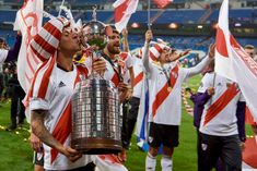 River Plate's Enzo Perez holds the trophy after winning the second. Santiago Bernabeu, Sports Images, Carp, Two By Two, Football, Plates, History, Mariana, Amor