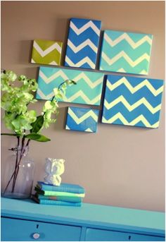 gather some shoe box lids (cheaper than canvases!) and paint the same design in a few different shades to add a serene touch to your room.