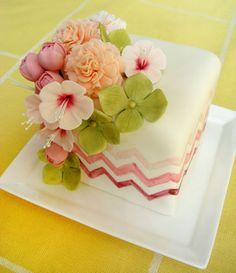 Chevron and sugar spring flowers mini cake. The ombré chevrons are hand-painted. I love the soft pinks and spring greens.