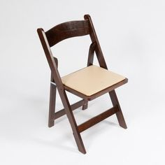 Fruitwoodfolding chair with padded seat - most comfortable to sit in. Easy to stack, move, andcomplete the look of your...