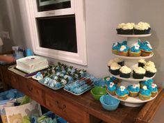 Dessert table #chocolate covered strawberries #chocolate covered pretzels #blue velvet cupcakes #ice cream cake