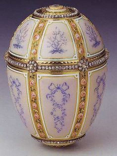 (all the kelch eggs were made as extravagant as the Romanov eggs) -Gifted by Alexander Kelch to his wife Barbara Kelch-Bazanova. The 1899 Kelch 12 Panel Egg is made of yellow gold, rose-cut diamonds, portrait diamonds, translucent pink and green enamel and opaque white enamel.This is the only Kelch Egg that was not part of the lot bought by the Paris jeweler Morgan. Probably it was Barbara Kelch's favorite Egg and the one she hold on the longest. It now belongs to Queen Elizabeth II.