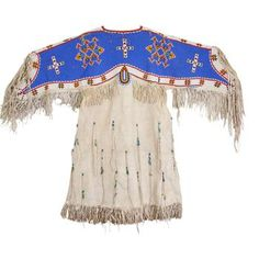 View this item and discover similar for sale at - Sioux beaded hide dress. Fully beaded cape both sides on brain tanned hide with geometric and cross motif with stylized deer tail design and Native American Shirts, Native American Wisdom, Native American Clothing, Native American Tribes, Native American Fashion, Indian Beadwork, Native Beadwork, Native American Beadwork, Beaded Cape