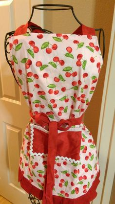 Pink, red, cherry print apron with matching potholder by TheStitchinCorner on Etsy