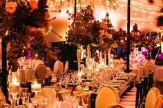 Bird cages, string lights, and lots of flowers! #romance #reception #tent