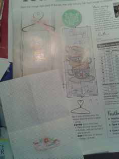 The start of a beautiful cross stitch on a hanger.
