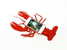 Lobster Mobile Telephone Case // The red 'Lobster Mobile Telephone Case' is a modern appropriation of Salvador Dali's 'Lobster Telephone' (Aphrodisiac telephone), created in 1938.    Unlike the typical phone case, it doesn't offer functionality of protection and style. Its features include; camera incapability, ergonomically awkward, too big for your pocket or handbag and most importantly, it's ability to cause its users embarrassment.
