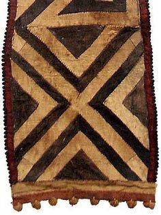 Kuba barkcloth  (must have a look on this website ! wonderful stuff !)    http://www.hamillgallery.com/KUBA/KubaBarkcloth3/KubaBarkcloth3.html