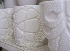 Ikuko Iwamoto  Slipcast ceramics inspired by minute organisms.  (Each raised bump is applied individually by hand!)