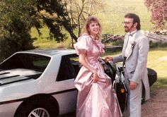Where to start on the #80s goodness in this photo?  The pink poofy-sleeved dress? Her hair? His gray tux? Let's not forget the bitchin' Fiero.