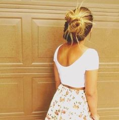 Crop top and high waisted skirt with perfect messy bun