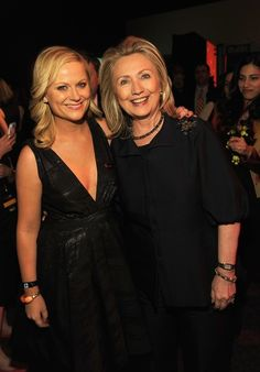 Hillary in intimate pose with female celebrity.