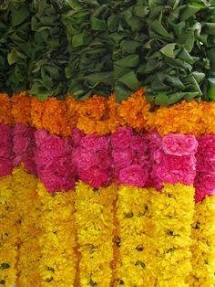 On budget for flower garlands...try using inexpensive flowers like carnations.