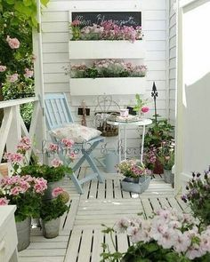 Give your patio space a shabby chic overhaul with white painted wood and plenty of floral displays