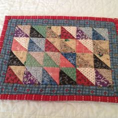 scrappy mug rug - must do....help me use all those half square triangles