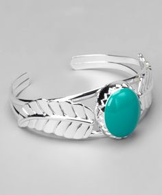 Take a look at this Teal & Silver Feather Cuff by Pavcus Designs on #zulily today!