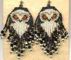Large beaded fringed snow owl earrings.: