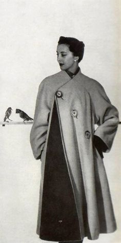 Model in interesting coat by Schiaparelli, photo by Georges Saad, 1951