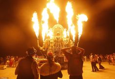 flames from El Pulpo Mecanico during the Burning Man Fertility 2.0 arts and music festival in the Black Rock Desert of Nevada August 29, 2012