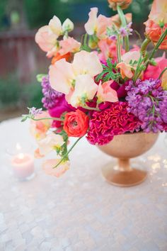 Colorful floral centerpiece | Connie Dai Photography | http://burnettsboards.com/2014/01/style-backyard-engagement-party/