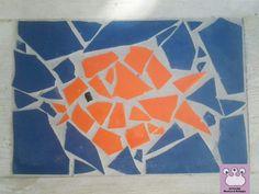 mosaico disegno pesce realizzato con scarti di mattonelle rotte per una casa al mare