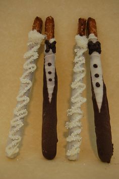 "Pretzel rods decorated as ""bride and groom"""